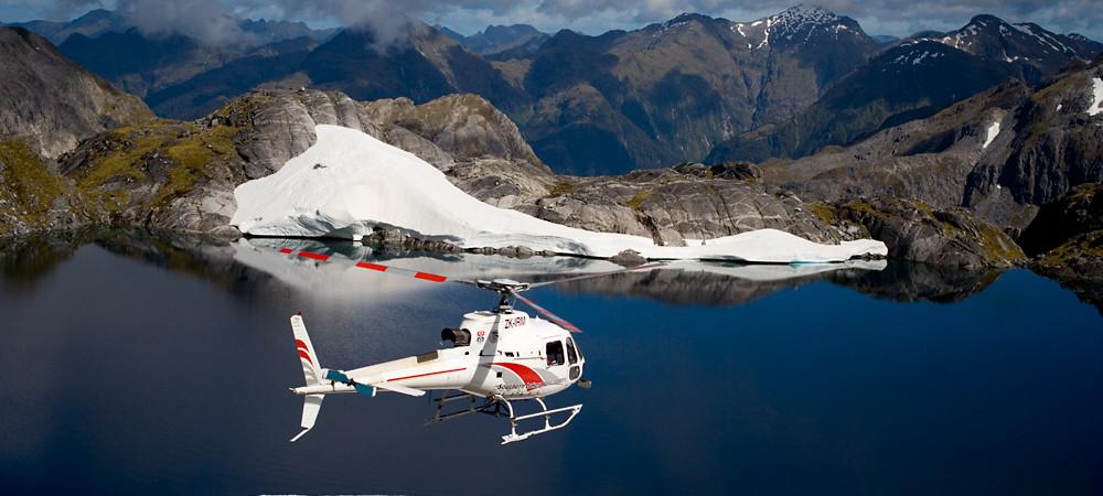 Helicopter flying over Mt Kidd, Te Anau.